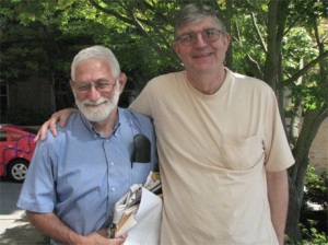 Lee Perlman, left, with his journal for furiously taking down notes. Pictured with Mike Warwick