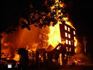 Flames engulfing building at MLK and Monroe. Photo from Portland Fire and Rescue.