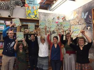 Holding up Oregon Reads Aloud book
