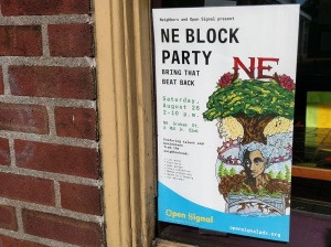 Poster in window for Open Signal block party