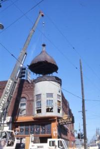 Crane removing the cupola on the Hill Block building