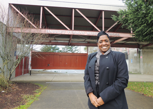 Principal Natasha Butler in front of the new Harriet Tubman Middle School
