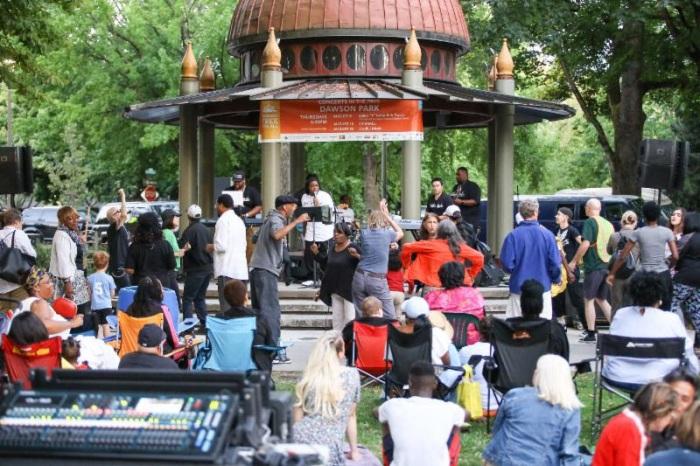 Dawson Park gazeebo with band and concert goers.