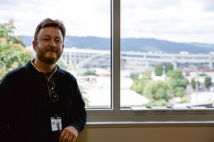 Paul Bubl standing in front of classroom window